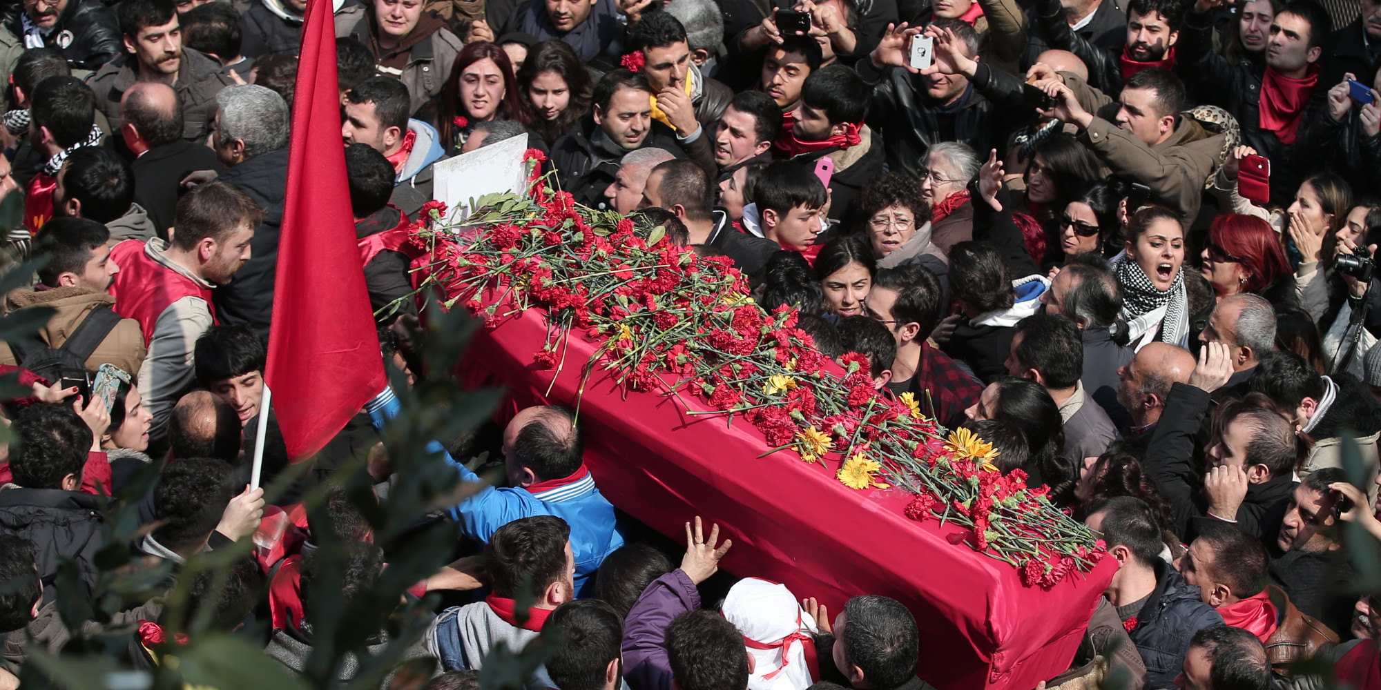 The people carry the coffin of Berkin Elvan, a Turkish teenager who was in a coma since being hit in the head by a tear gas canister fired by police during the summer's anti-government protests, during his funeral in Istanbul, Turkey, Wednesday, March 12, 2014. On Wednesday, thousands converged in front of a house of worship calling for Prime Minister Recep Tayyip Erdogan to resign.(AP Photo/Emrah Gurel)